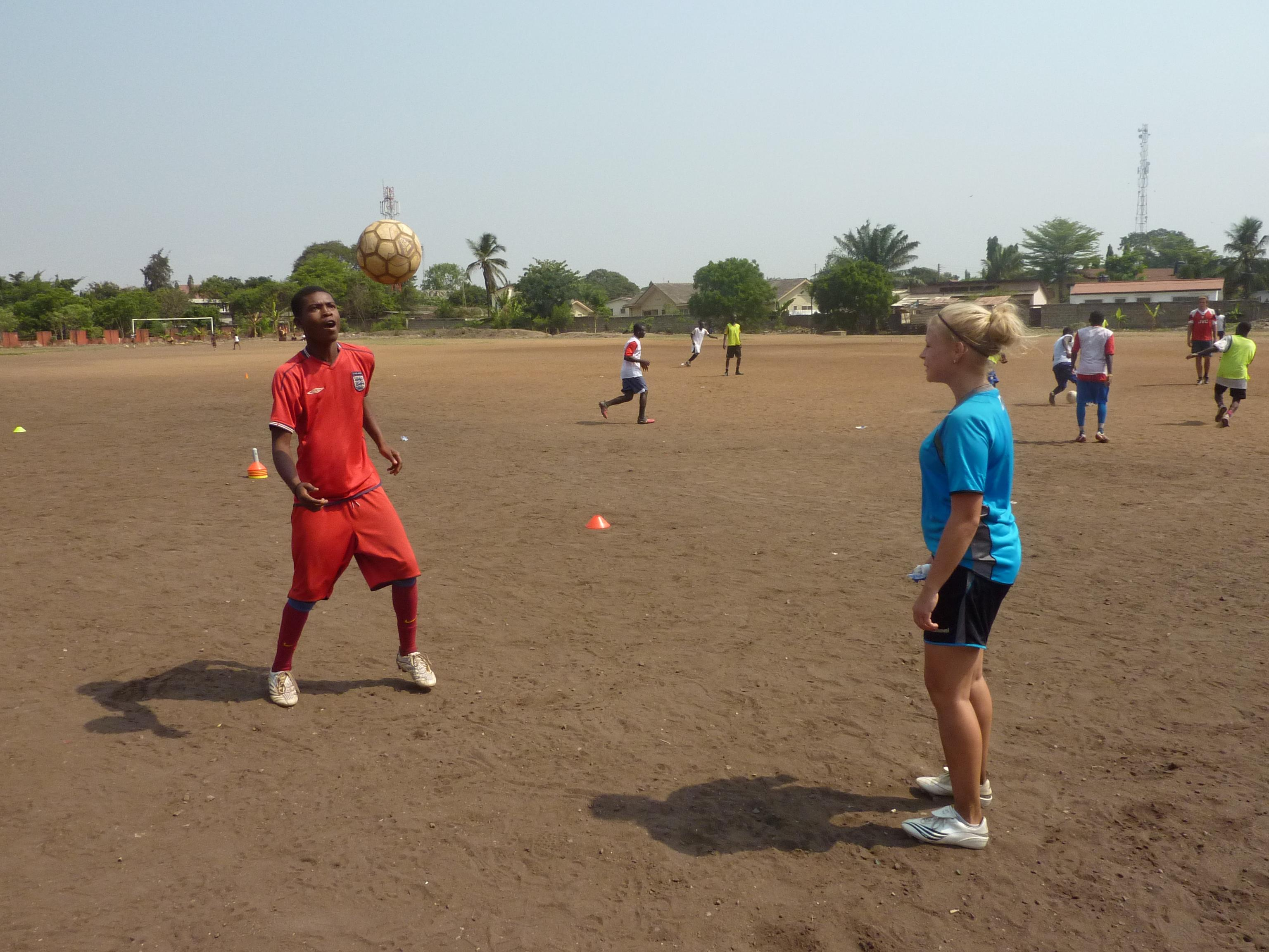 A woman volunteers as a football coach in Ghana to share her skills with others